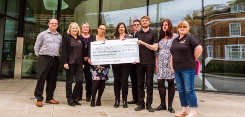 Hiscox staff in york handover cheque to York Sands